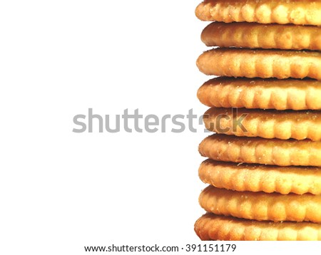 BISCUITS - A stack of delicious round biscuits isolated on white background with copy space for text. - stock photo