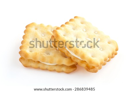 BISCUITS - A stack of square biscuits puff sandwich lemon flavoured cream isolated on white - stock photo