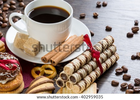 Biscuits and coffee on table - stock photo