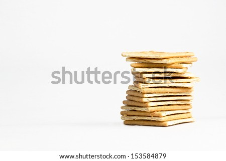 Biscuits arranged in a layer with white background - stock photo