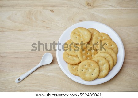 biscuits inside white plate on the table