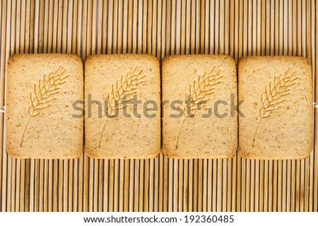 Biscuits on a bamboo mat - stock photo