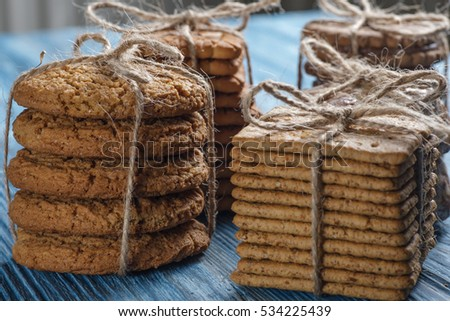 Biscuits tied with string on vintage wooden table
