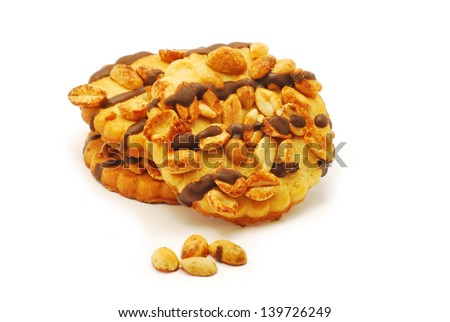 Biscuits with nuts and chocolate on white background - stock photo