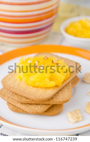 Biscuits with orange marmalade closeup