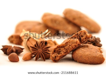 Biscuits with walnuts and cinnamon on a white background - stock photo