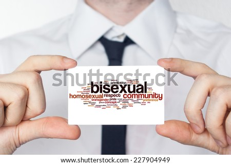 Bisexual. Businessman in white shirt with a black tie showing or holding business card - stock photo