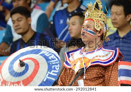 BISHAN,SINGAPORE-JINE1:Unidentified Thai fans in action during the 28th SEA Games Singapore 2015 match between Thailand and Timor Leste at Bishan Stadium on June1 2015 in,SINGAPORE. - stock photo