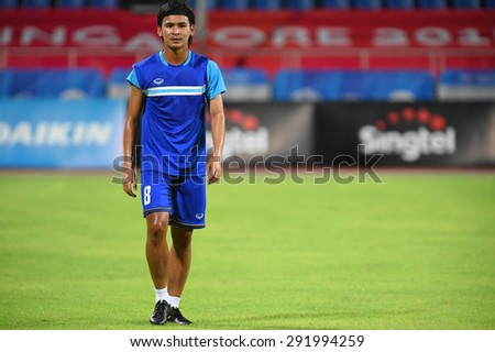 BISHAN,SINGAPORE-JUNE1: Artit Daosawang of Thailand in action before the 28th SEA Games Singapore 2015 match between Thailand and Timor Leste at Bishan Stadium on JUNE1 2015 in,SINGAPORE - stock photo