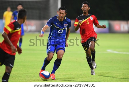 BISHAN,SINGAPORE-JUNE1: Chananan Pombubpha(23) of Thailand in action during the 28th SEA Games Singapore 2015 match between Thailand and Timor Leste at Bishan Stadium on JUNE1 2015 in,SINGAPORE - stock photo