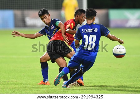 BISHAN,SINGAPORE-JUNE1: Sarach Yooyen(L1) of Thailand in action during the 28th SEA Games Singapore 2015 match between Thailand and Timor Leste at Bishan Stadium on JUNE1 2015 in,SINGAPORE - stock photo