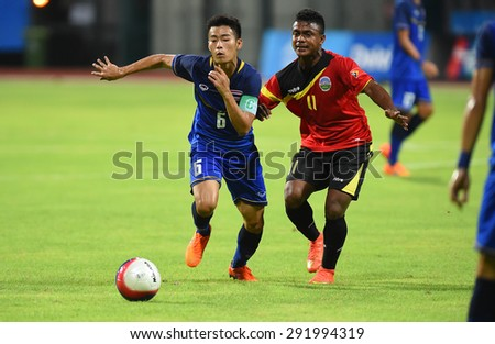 BISHAN,SINGAPORE-JUNE1: Sarach Yooyen(6) of Thailand in action during the 28th SEA Games Singapore 2015 match between Thailand and Timor Leste at Bishan Stadium on JUNE1 2015 in,SINGAPORE - stock photo