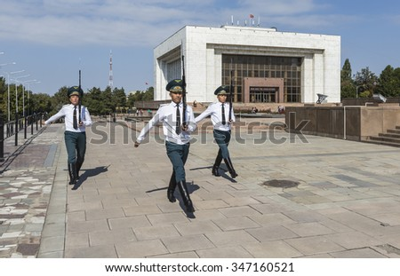 Bishkek, Kyrgyzstan - September 27, 2015: Photo of the hourly guard shift at the official flagpole in Kyrgyzstan's capitol city. - stock photo