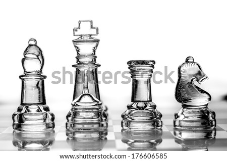 bishop, king, rook and knight chess pieces made out of glass