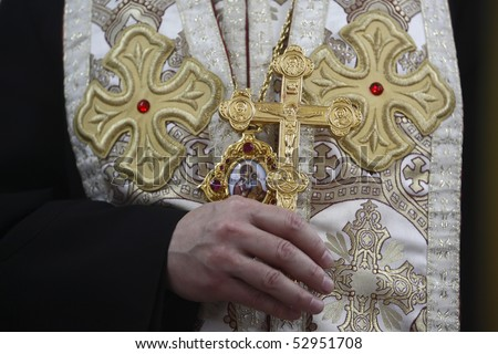 Bishop with cross during the ceremony - stock photo