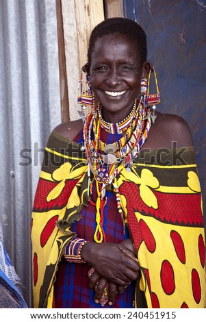 BISIL, KENYA-DECEMBER 7, 2010: Unidentified Maasai woman near the village of Bisil in southern Kenya wears traditional jewelry and tribal piercings - stock photo