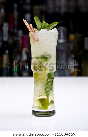 bison grass cocktail with crushed ice and apple slices - stock photo
