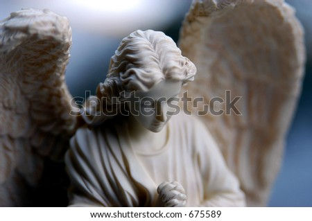 Bisque statue of angel - stock photo