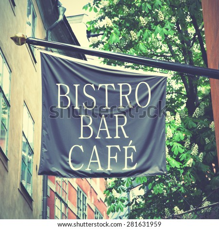 Bistro bar cafe sign on flag in the street. Retro style filtred image - stock photo