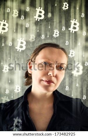 Bitcoin concept. Businesswoman collecting bitcoins, virtual currency. - stock photo