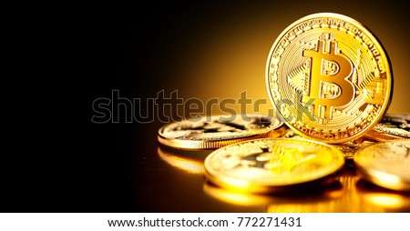 Bitcoin. Crypto currency Gold Bitcoin, BTC, Bit Coin. Macro shot of Bitcoin coins isolated on black background Blockchain technology, bitcoin mining concept.