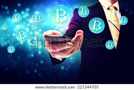 Bitcoin currency with a smart phone and businessman - stock photo