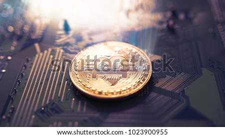 Bitcoin symbol and electrical circuit background. Crypto currency
