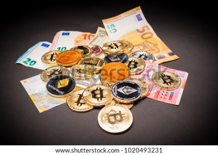 Bitcoins and Banknotes (Euro, Swiss Franc and Dollar)