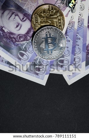 Bitcoins and great britain or england real paper pounds on blank board with copy space and text area
