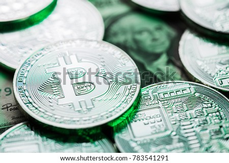 Bitcoins on one dollar bill. Conceptual image showing the competition between old and new currencies. Future of worldwide digital payment.
