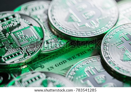 Bitcoins on one dollar bill. The headline is showing the uncertainty, instability, unsteadiness of the new cryptocurrency.