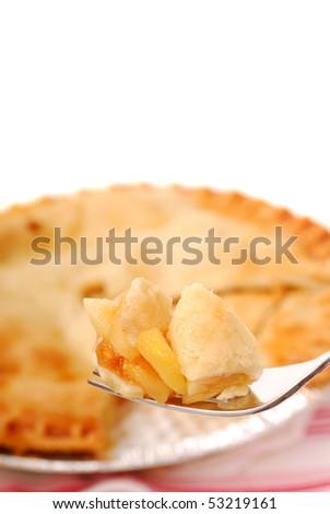 Bite of freshly baked apple pie on a fork - stock photo