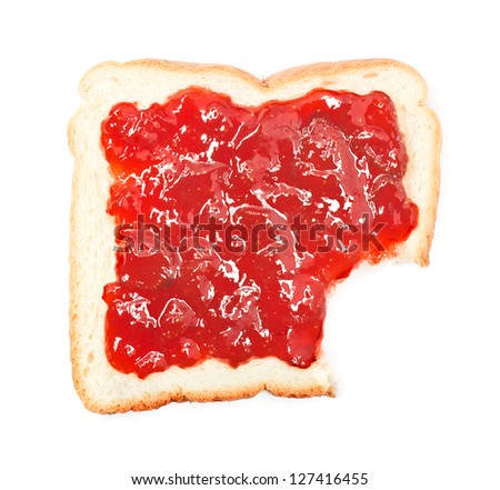 bite out of a slice of bread with strawberry jam on white background
