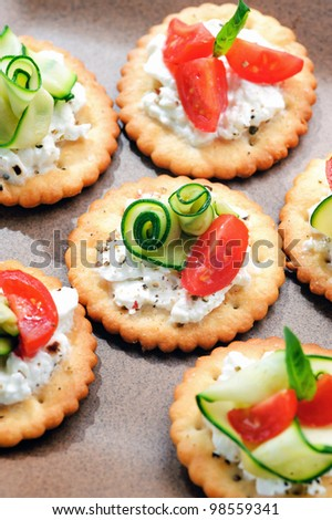 Bite size canapes with cottage cheese, courgette and tomato - stock photo