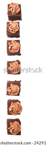 Bite sized chocolate cake with icing on top over white background - stock photo