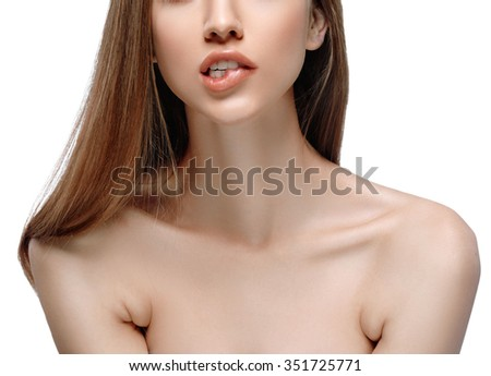 Biting lip neck shoulders Beautiful woman face close up portrait young studio on white - stock photo