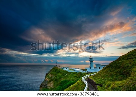 Bitou Cape Lighthouse at Dawn - stock photo