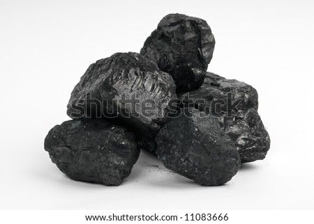 Bits of carbon on a white background (carbon totem) - stock photo