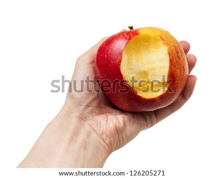 bitten apple in hand, isolated on white background - stock photo