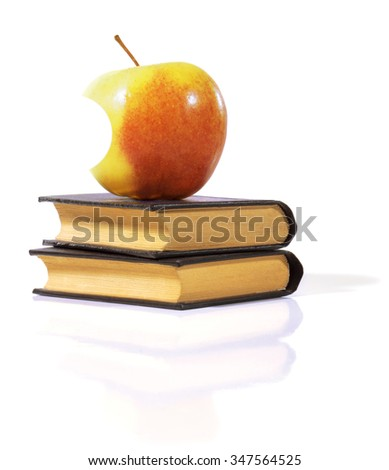 Bitten apple on a books isolated on white - stock photo