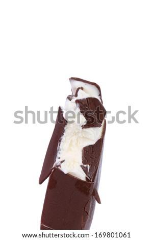 Bitten chocolate vanilla ice cream on stick. Isolated on a white background. - stock photo
