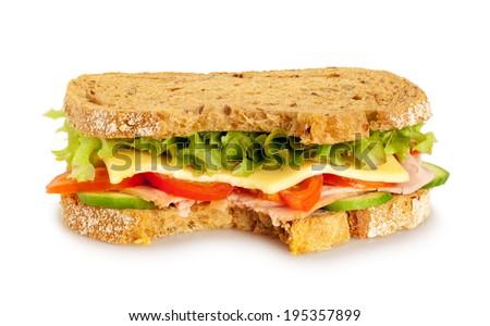 Bitten fresh sandwich (whole grain bread) on white background - stock photo