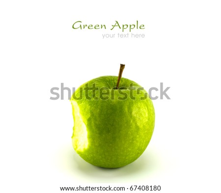 Bitten green apple on white background with copy space. - stock photo