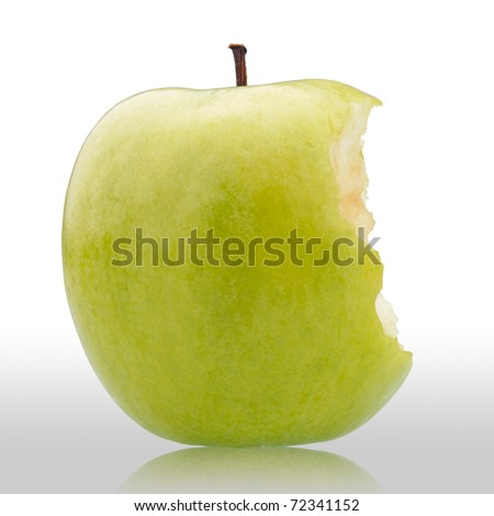 bitten green apple on white background with reflection - stock photo