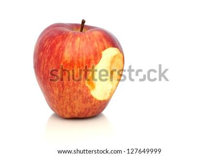 Bitten off red apple. - stock photo