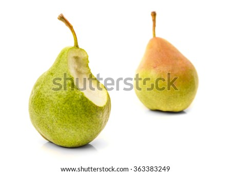 Bitten pear and one full. Isolated on white background