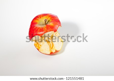 Bitten red apple isolated on white. - stock photo