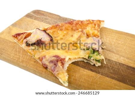 bitten slice of pizza - stock photo