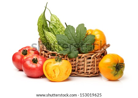 Bitter melon and tomatoes on white background