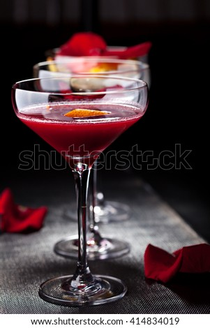 Bitter Sweet Cocktail - Gin, Campari and Berry Syrup - stock photo